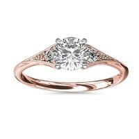 0.70 克拉圆形钻石+ 家传之宝小巧锯状钻石戒托