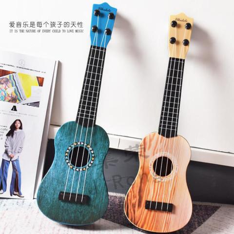小小乐 儿童初学音乐玩具小吉他仿真尤克里里可弹奏乐器 2把
