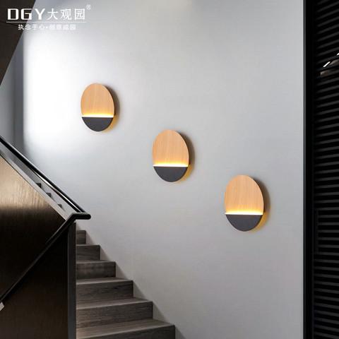 北欧后现代个性创意圆形客厅餐厅卧室床头灯设计师三角形壁灯