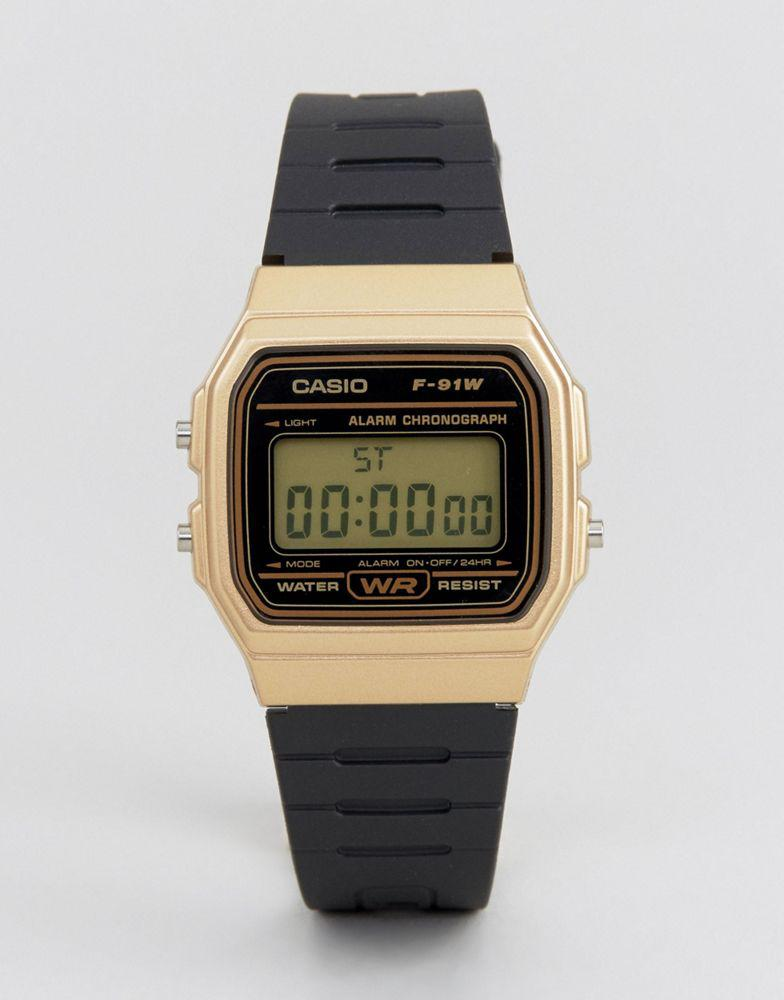 Casio 卡西欧 F91WM-9A digital silicone strap watch in black/gold